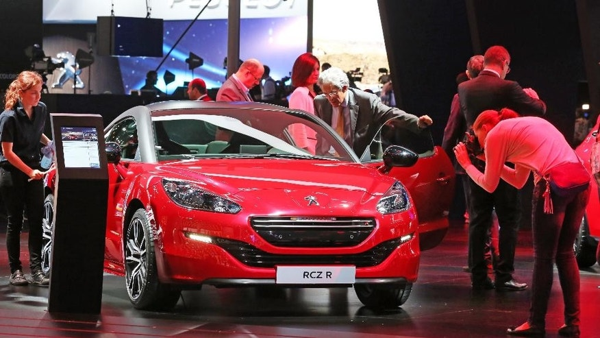 The Peugeot RCZ R is presented at the Paris Motor Show, in Paris, Thursday Oct. 2, 2014. The Paris Motor Show will open its doors to the public on Saturday Oct. 4, until Oct. 19.  European carmakers are hoping to impress with new models at this week's Paris Motor Show and prove they have come out stronger from years of economic trouble and cost-cutting. (AP Photo/Remy de la Mauviniere)