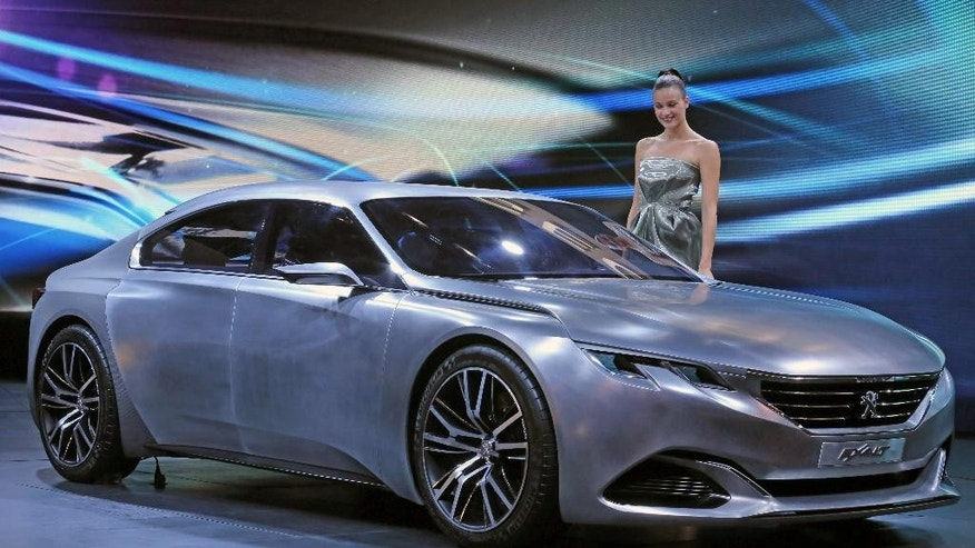 The Peugeot concept car Exalt is presented at the Paris Motor Show, in Paris, Thursday Oct. 2, 2014. The Paris Motor Show will open its doors to the public on Saturday Oct. 4, until Oct. 19.  European carmakers are hoping to impress with new models at this week's Paris Motor Show and prove they have come out stronger from years of economic trouble and cost-cutting. (AP Photo/Remy de la Mauviniere)