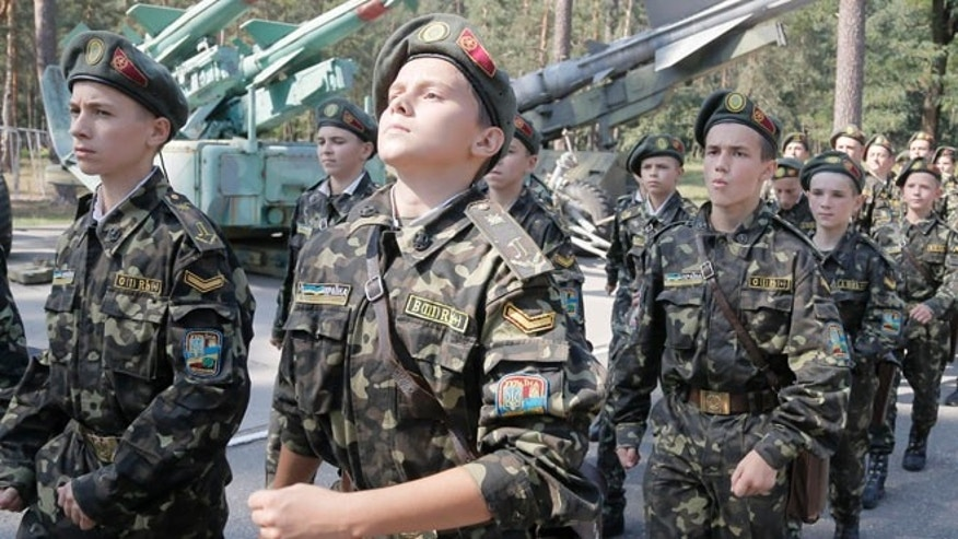 Sept. 9, 2014:  Students march during military training exercises in a military school in Boyarka