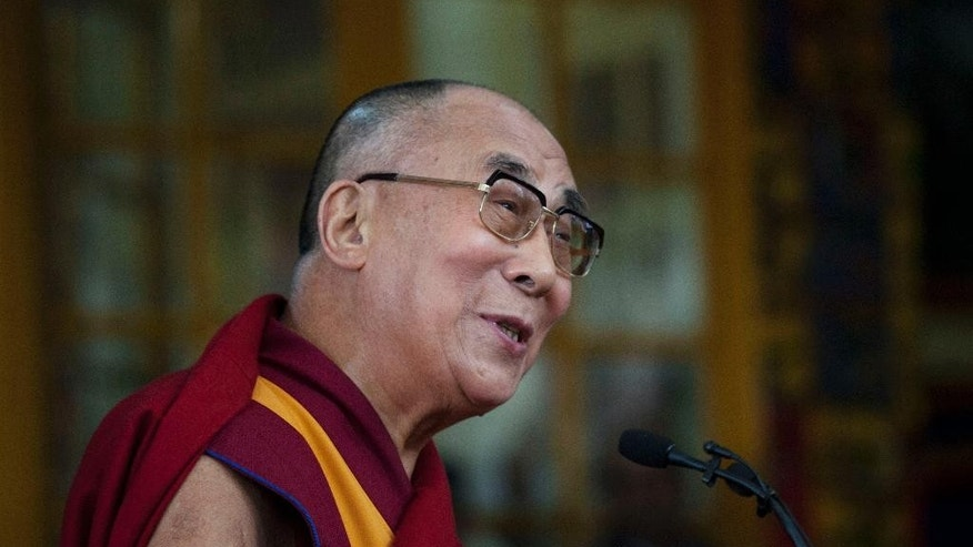 Tibetan spiritual leader the Dalai Lama speaks to a crowd during an event marking 25 years since the leader was awarded the Nobel Peace Prize, in Dharmsala, India, Thursday, Oct. 2, 2014. (AP Photo/Ashwini Bhatia)