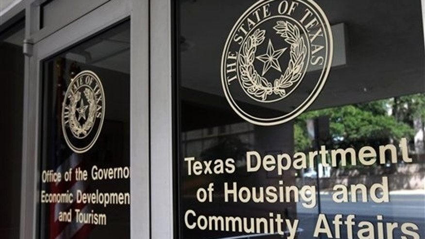 This photo taken Aug. 30, 2014, shows the Texas Department of Housing and Community Affairs in Austin, Texas. Over the past two years, civil rights advocates have managed to prevent the Supreme Court from deciding an issue after the justices agreed to hear a case by coaxing settlements in a pair of high-profile housing discrimination cases weeks before the court was set to hear oral arguments. Those last-minute settlements may have pushed the issue down the road but the court could decide as early as this month whether to take up another disparate impact case, in which Texas officials are accused of racial bias for steering low-income housing into mostly black neighborhoods. (AP Photo/Eric Gay)