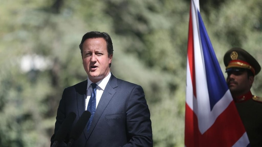 Britain's Prime Minister David Cameron talks during a joint  news conference with Afghanistan's president Ashraf Ghani Ahmadzai, at the presidential palace in Kabul, Afghanistan, Friday, Oct. 3, 2014. Britain's Prime Minister David Cameron on Friday pledged support for Afghanistan's newly sworn-in president and the country's new unity government, saying during a surprise visit to Kabul that Britain is committed to helping Afghans build a more secure and prosperous future. (AP Photo/Massoud Hossaini)