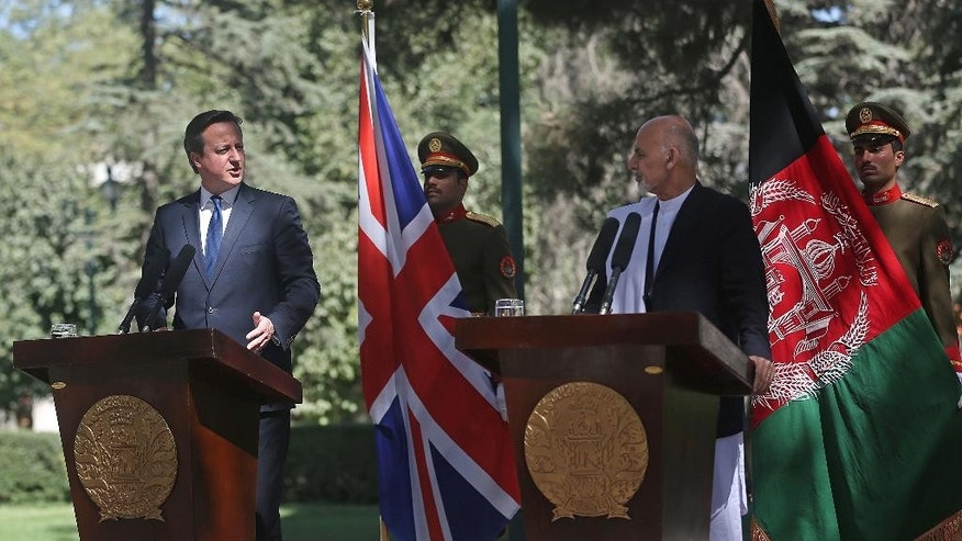 Afghanistan's president Ashraf Ghani Ahmadzai, second right, listens as Britain's Prime Minister David Cameron talks during a news conference at the presidential palace in Kabul, Afghanistan, Friday, Oct. 3, 2014. Britain's Prime Minister David Cameron on Friday pledged support for Afghanistan's newly sworn-in president and the country's new unity government, saying during a surprise visit to Kabul that Britain is committed to helping Afghans build a more secure and prosperous future. (AP Photo/Massoud Hossaini)
