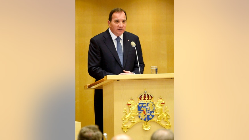 Sweden's new Prime Minister Stefan Lofven announces his new government in the Swedish Parliament in Stockholm Friday, Oct. 3, 2014. (AP Photo/Jonas Ekstromer, TT News Agency)  SWEDEN OUT