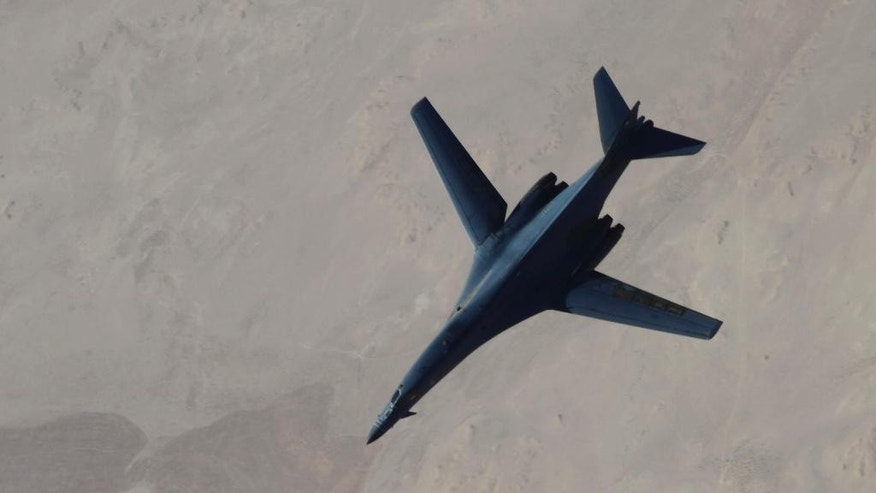 In this Saturday, Sept. 27, 2014 photo released by the U.S. Air Force, a B-1B Lancer disengages from a KC-135 Stratotanker after refueling during U.S.-led airstrikes on Islamic State group targets in Syria. Nearly 2 out of 3 Americans back U.S. airstrikes to combat Islamic extremists and half also think there's a high risk of a future terrorist attack on American soil. Americans surveyed for an Associated Press-GfK poll are split on whether they approve of the way President Barack Obama is generally handling the threat from the Islamic State group and other terrorists. Yet despite more than a decade of costly war, about a third favor going even beyond airstrikes and putting U.S. military boots on the ground in Iraq or Syria — something Obama says he has no plans to do. (AP Photo/Staff Sgt. Ciara Wymbs, U.S. Air Force)