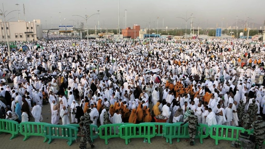 Muslim pilgrims gather at the Plain of Arafat during the annual pilgrimage, known as the hajj, near Mecca, Saudi Arabia, Friday, Oct. 3, 2014. An estimated 2 million Muslims are streaming into a sprawling tent city near Mecca for the annual hajj pilgrimage. (AP Photo/Khalid Mohammed)