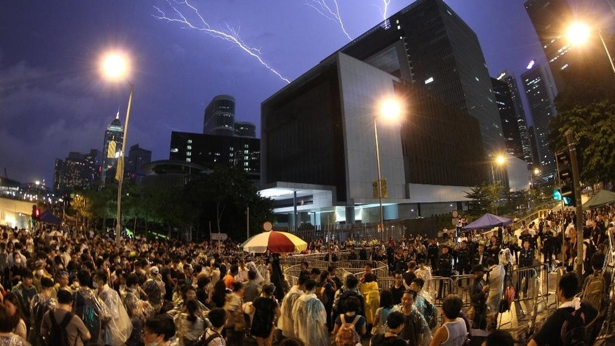 Lightning is seen during a rally near government office in Hong Kong Friday, Oct. 3, 2014 in Hong Kong. Hong Kong pro-democracy protesters canceled planned talks with the government on electoral reforms Friday after mobs of people tried to drive them from streets they had occupied in one of the city's main shopping areas.(AP Photo/Apple Daily) HONG KONG OUT, TAIWAN OUT