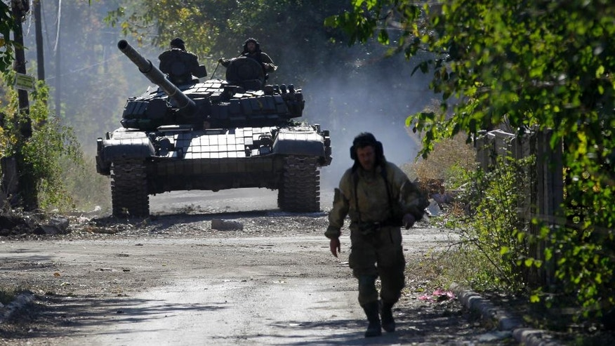 Oct. 3, 2014 - A pro-Russian rebel tank taking position near the airport in Donetsk, eastern Ukraine. Artillery fire hit Donetsk airport as Pro-Russian rebels press to seize the key airport despite fierce resistance from government forces.