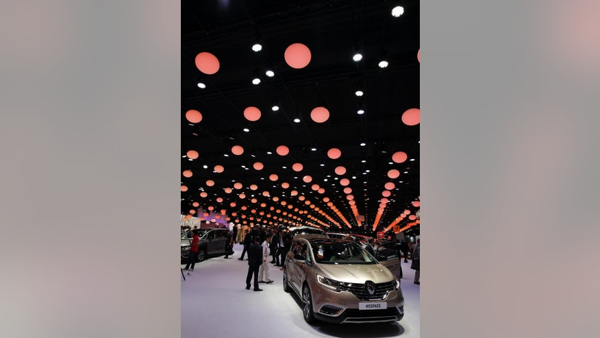 A Renault Espace is presented at the Paris Motor Show, in Paris, Thursday Oct. 2, 2014. The Paris Motor Show will open its doors to the public on Saturday Oct. 4, until Oct. 19. Carmakers are hoping to impress with new models at this week's Paris Motor Show and prove they have come out stronger from years of economic trouble and cost-cutting. (AP Photo/Christophe Ena)