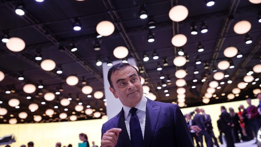 Renault Nissan chairman Carlos Ghosn addresses members of the media at the Paris Motor Show, in Paris, Thursday Oct. 2, 2014. The Paris Motor Show will open its doors to the public on Saturday Oct. 4, until Oct. 19. Carmakers are hoping to impress with new models at this week's Paris Motor Show and prove they have come out stronger from years of economic trouble and cost-cutting. (AP Photo/Christophe Ena)