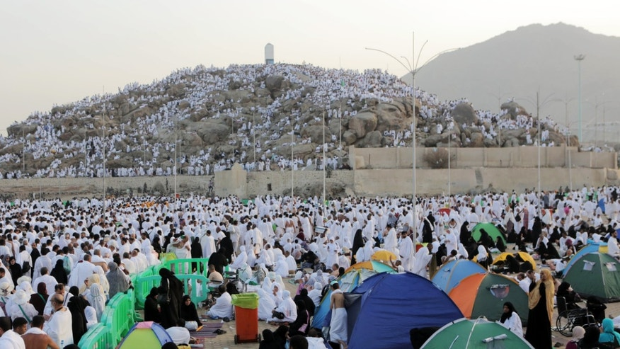 Oct. 3, 2014 - Muslim pilgrims gather to pray at the Plain of Arafat during the annual hajj pilgrimage, near Mecca, Saudi Arabia. Some 2 million Muslims are streaming into a tent city near Mecca. Saudi Arabia banned hajj and work visas this year for people from Sierra Leone, Liberia and Guinea as a precaution to avoid the spread of Ebola.