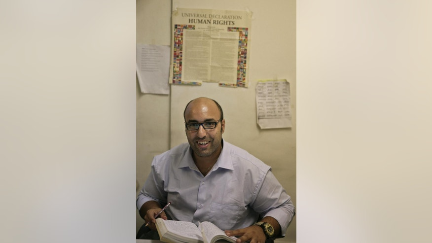 In this Tuesday, Sept. 30, 2014 photo, Mohammed Zaree, the Egypt program manager for the Cairo Institute for Human Rights Studies, poses for a photograph in his office in Cairo, Egypt. Civil society groups in Egypt long had a tenuous position under the rule of autocrat Hosni Mubarak, but they were able to operate. Now those groups, ranging from human rights defenders to advocates of economic justice, fear even that margin of freedom is disappearing and that they are on the way to being silenced. (AP Photo/Nariman El-Mofty)