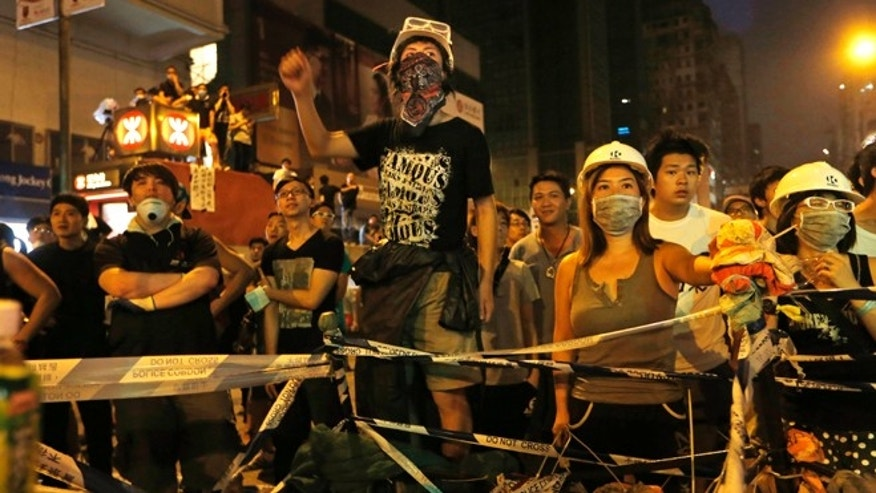 Oct. 5, 2014: Pro-democracy protesters stage a rally on a occupied road in Mong Kok district, Hong Kong. (AP)