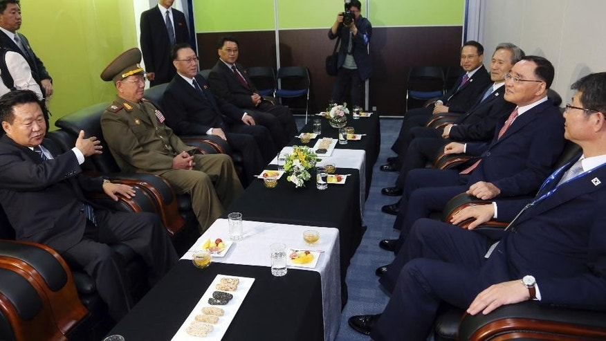 North Korea's National Defense Commission Vice Chairman Hwang Pyong So, second left, and North Korea's ruling Workers Party secretaries, Choe Ryong Hae, left, and Kim Yang Gon, meet with  South Korean Unification Minister Ryoo Kihl-jae, right, South Korean Prime Minister Chung Hong-won, second right, and South Korean President Park Geun-hye's National Security Adviser Kim Kwan-jin , third right, meet as they arrive to attend the closing ceremony for the 17th Asian Games in Incheon, South Korea, Saturday, Oct. 4, 2014. Hwang, North Korea's presumptive No. 2, and other members of Pyongyang's inner circle met with South Korean officials Saturday in the rivals' highest level face-to-face talks in five years, a possible indication that both sides are interested in pursuing better ties after months of animosity. (AP Photo/Yonhap, Bae Jae-man) KOREA OUT