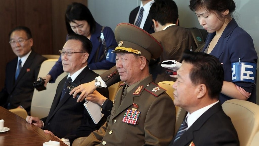 Hwang Pyong So, vice chairman of North Korea's National Defense Commission, center, is flanked by secretaries of North Korea's ruling Workers' Party Choe Ryong Hae, right, and Kim Yang Gon, while attending a luncheon meeting with South Korean officials at a hotel in Incheon, South Korea, Saturday, Oct. 4, 2014. Hwang, North Korea's presumptive No. 2 and other members of Pyongyang's inner circle made a surprise trip Saturday to South Korea for the close of the Asian Games, with the rivals holding their highest level face-to-face talks in five years.(AP Photo/Yonhap, Yun Tae-hyun) KOREA OUT