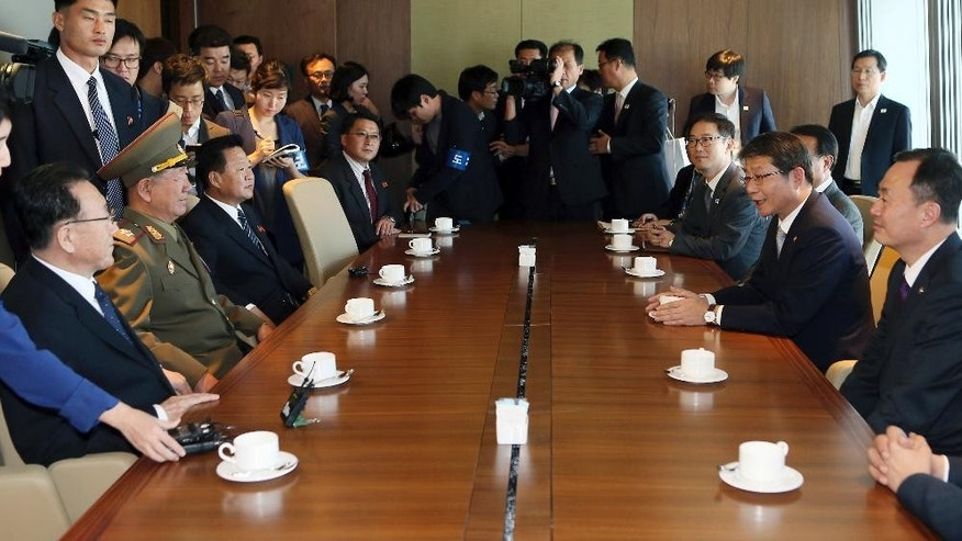 Hwang Pyong So, center left, vice chairman of North Korea's National Defense Commission, is flanked by secretaries of North Korea's ruling Workers' Party Kim Yang Gon, left, and Choe Ryong Hae  as they listen to South Korean Unification Minister Ryoo Kihl-jae, right center, during a luncheon meeting with South Korean officials at a hotel in Incheon, South Korea, Saturday, Oct. 4, 2014. Hwang, North Korea's presumptive No. 2 and other members of Pyongyang's inner circle made a surprise trip Saturday to South Korea for the close of the Asian Games, with the rivals holding their highest level face-to-face talks in five years. (AP Photo/Yonhap, Yun Tae-hyun) KOREA OUT