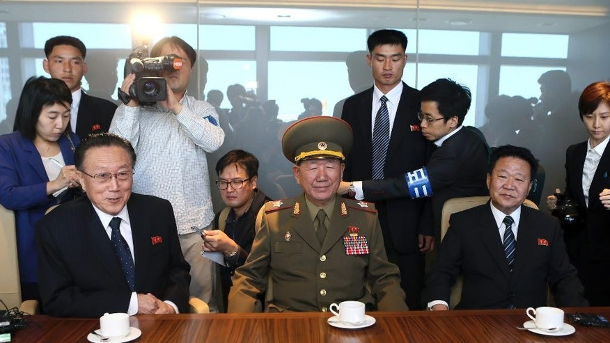 From left, Kim Yang Gon, a secretary of North Korea's ruling Workers' Party, Hwang Pyong So, vice chairman of North Korea's National Defense Commission, and Choe Ryong Hae, a secretary of  North Korea's ruling Workers' Party, attend a luncheon meeting with South Korean officials at a hotel in Incheon, South Korea, Saturday, Oct. 4, 2014. Hwang, North Korea's presumptive No. 2 and other members of Pyongyang's inner circle made a surprise trip Saturday to South Korea for the close of the Asian Games, with the rivals holding their highest level face-to-face talks in five years.  (AP Photo/Yonhap, Yun Tae-hyun) KOREA OUT