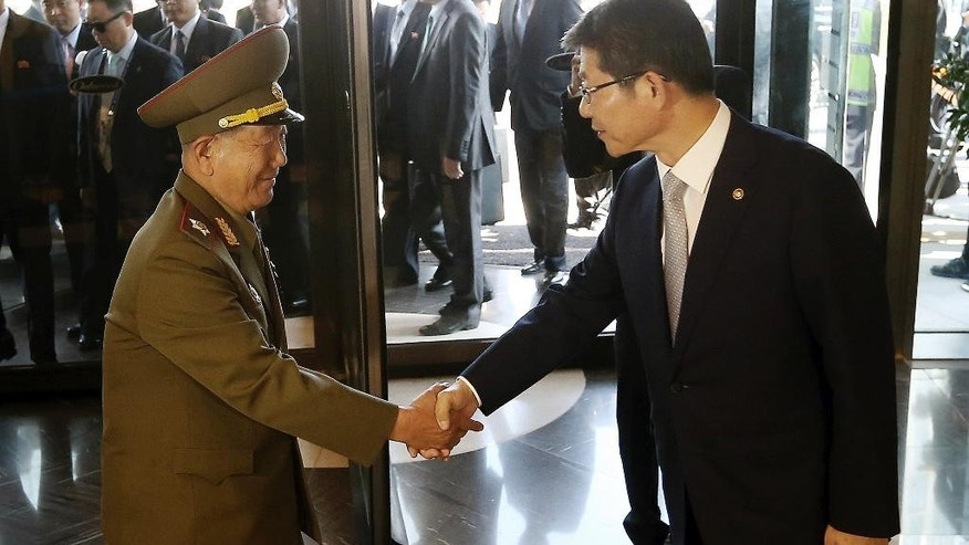 Oct. 4, 2014: Hwang Pyong So, left, vice chairman of North Korea's National Defense Commission, shakes hands with South Korean Unification Minister Ryoo Kihl-jae upon his arrival at a hotel in Incheon, South Korea.