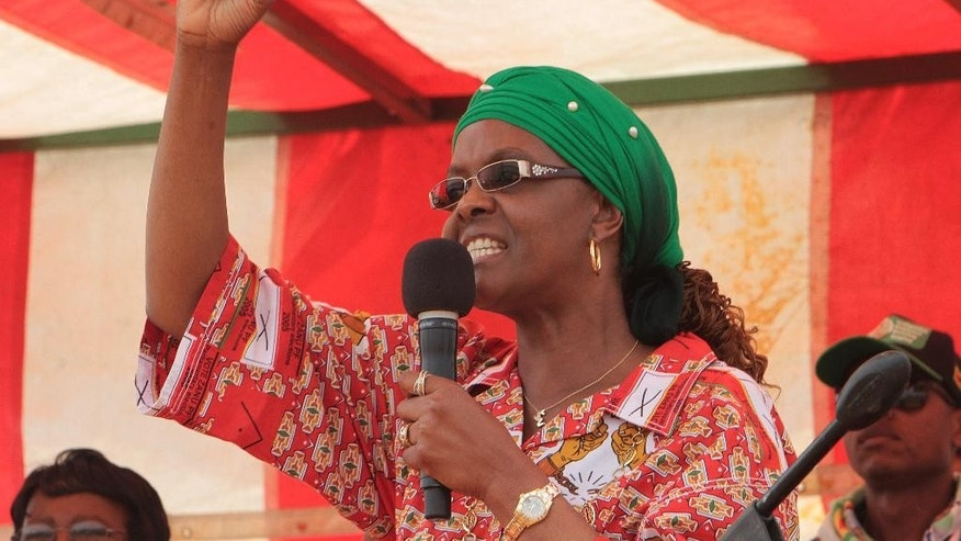 Zimbabwe's first lady Grace Mugabe addresses a rally in Chinhoyi, about 120 kilometres west of Harare, Thursday, Oct. 2, 2014. In her speech Mugabe castigated factionalism in the ruling Zanu PF party, as she embarked on her maiden political rally since been nominated to head the Zanu PF ruling party women's league in July. The rally held in the small farming town of Chinhoyi marked the vivacious 49-year-old's first steps to shore up her political credentials outside President Robert Mugabe's shadow .(AP Photo/Tsvangirayi Mukwazhi)