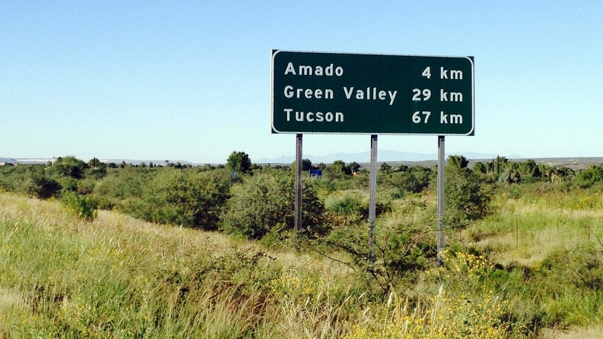 This Tuesday, Sept. 30, 2014 photo shows a sign on northbound Interstate 19, near Amado, Ariz., in the southern part of the state, that tells drivers they are kilometers away from their destination. Although other highways around the country have some metric signs, I-19 is the only continuous highway that is entirely in the metric system. The signs were installed nearly 40 years ago as part of pilot program that aimed to introduce the use of the metric system in the United States. (AP Photo/Astrid Galvan)
