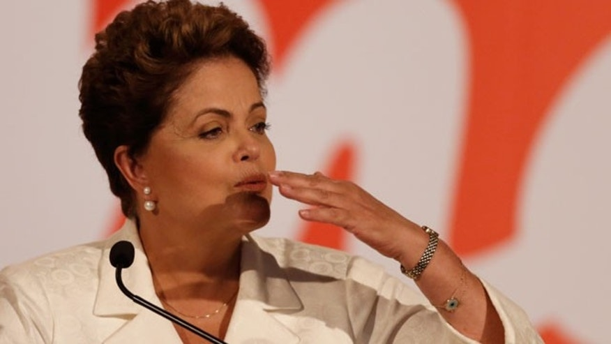 October 5, 2014: Brazil's President Dilma Rousseff blows a kiss during a press conference in Brasilia. Official results showed Sunday that President Dilma Rousseff will face challenger Aecio Neves in a second-round vote in Brazil's most unpredictable presidential election since the nation's return to democracy nearly three decades ago. (AP Photo/Eraldo Peres)