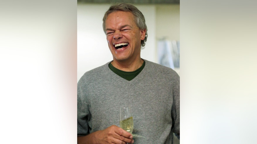 Winner of the 2014 Nobel Prize for Medicine Edvard Moser of Norway laughs after a news conference in Munich, southern Germany, Monday, Oct. 6, 2014. He won the Nobel Prize alongside his wife May-Britt Moser and professor John O'Keefe of the University College London. (AP Photo/Matthias Schrader)