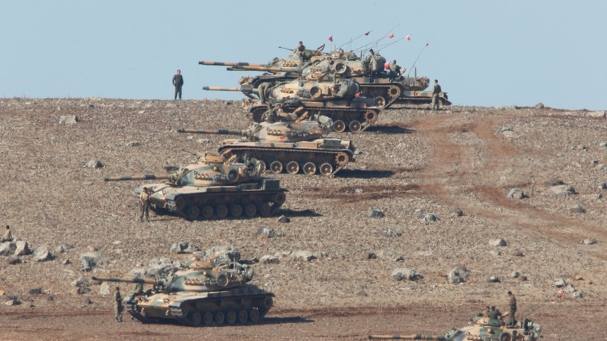 Oct. 6, 2014 - Turkish soldiers with tanks in the outskirts of Suruc, at the Turkey-Syria border, overlooking Kobani in Syria where fighting intensified between Syrian Kurds and the ISIS militants. Kobani and its surrounding areas have been under attack since mid-September, with militants capturing dozens of nearby Kurdish villages.
