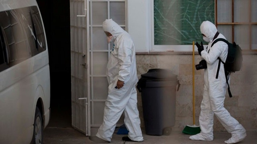 October 5, 2014: Forensic workers arrive at the morgue in Iguala Mexico. (AP Photo/Eduardo Verdugo)