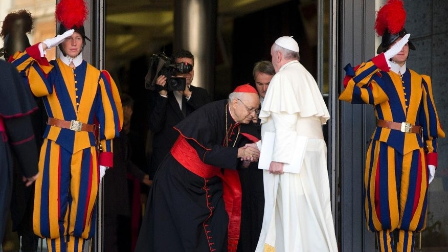 General Secretary of the Synod Cardinal Lorenzo Baldisseri bows as he welcomes Pope Francis for the morning session of a two-week synod on family issues including contraception, pre-marital sex and divorce, at the Vatican, Monday, Oct. 6, 2014. 200 cardinals and bishops from around the world have arrived in Rome for the meeting. (AP Photo/Alessandra Tarantino)