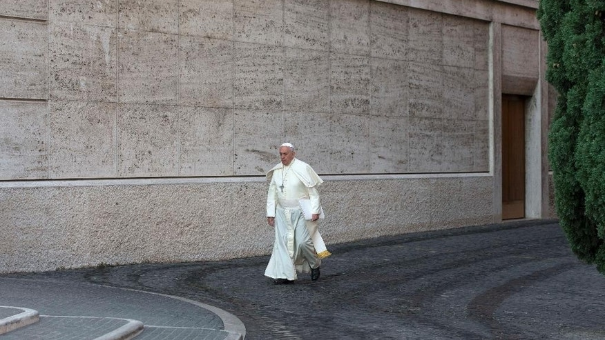 Pope Francis arrives at the morning session of a two-week synod on family issues including contraception, pre-marital sex and divorce, at the Vatican, Monday, Oct. 6, 2014. 200 cardinals and bishops from around the world have arrived in Rome for the meeting. (AP Photo/Alessandra Tarantino)