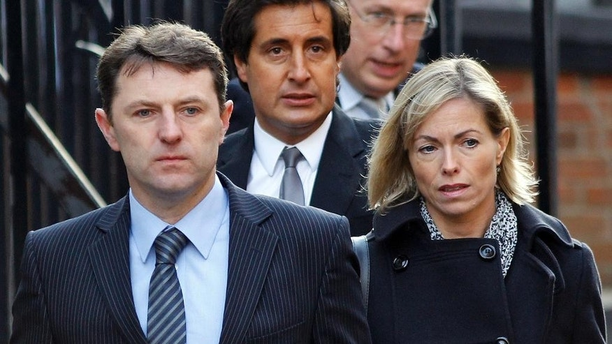 "FILE - In this Wednesday, Nov. 23, 2011 file photo, Gerry and Kate McCann arrive to testify at the Leveson inquiry at the Royal Courts of Justice in central London. A woman who was accused of sending Internet abuse to the parents of missing girl Madeleine McCann has been found dead in a hotel room in Leicester, central England, on Saturday Oct. 4, 2014. Her death has revived debate about media responsibility and how best to respond to online ""trolls."" (AP Photo/Lefteris Pitarakis, File)"