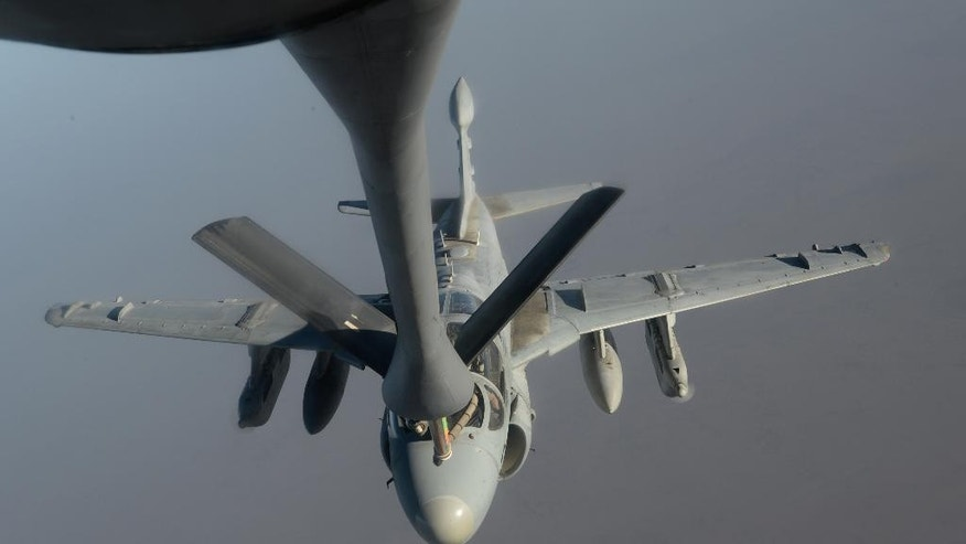 In this Saturday, Oct. 4, 2014 photo, released by the U.S. Air Force, A U.S. Navy EA-6B Prowler  supporting operations against the militant Islamic State group, receives fuel from a KC-135 Stratotanker over Iraq.  After two months, the U.S.-led aerial campaign in Iraq has so far hardly dented the core of the Islamic State group's territory. The extremists' grip on major cities across Iraq and neighboring Syria remains unquestioned. The campaign has brought some gains, with Kurdish fighters taking back towns on the fringes of the Islamic State group's territory. But those successes only underline a major weakness: Besides the Iraqi Kurds, there are no forces on the ground ready to capitalize on the airstrikes. (AP Photo/U.S. Air Force, Shawn Nickel)