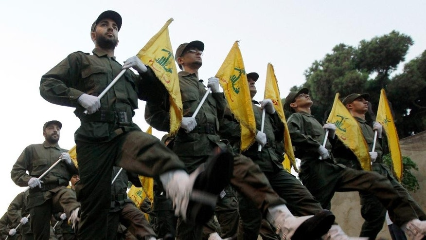 FILE - In this Nov. 12, 2010 file photo, Hezbollah fighters parade during the inauguration of a new cemetery for their fighters who died in fighting against Israel, at the southern suburb of Beirut, Lebanon.   An explosion along the Israel-Lebanon border wounded two Israeli soldiers Tuesday, Oct. 7, 2014,  and the military then fired toward Hezbollah positions in southern Lebanon in the most serious incident between the enemy countries in months. Hezbollah issued a statement on the group's Al Manar TV station claiming responsibility for the blast in Shebaa on Tuesday,  saying it targeted an Israeli patrol.   (AP Photo/Hussein Malla, File)