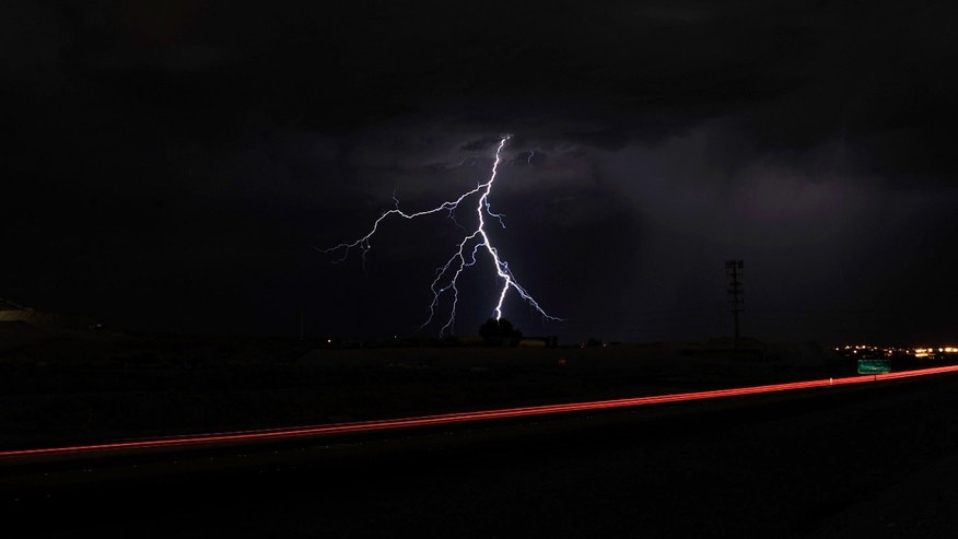 LAS VEGAS, NV - SEPTEMBER 13:  Lightning strikes northwest of the Las Vegas Beltway during a thunderstorm early on September 13, 2011 in Las Vegas, Nevada. Stormy weather is expected to continue through Thursday.  (Photo by Ethan Miller/Getty Images)