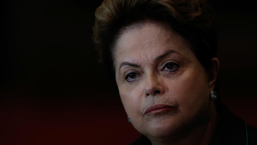 Brazil's President Dilma Rousseff, who is running for reelection with the Workers Party, PT, listens to a question during a campaign news conference at the Alvorada Palace, in Brasilia, Brazil, Monday, Oct. 6, 2014. Official results showed Sunday that President Dilma Rousseff will face challenger Aecio Neves in a second-round vote in Brazil's most unpredictable presidential election since the nation's return to democracy nearly three decades ago. (AP Photo/Eraldo Peres)