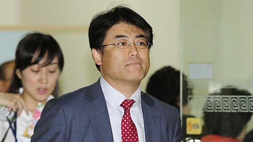 In this photo taken Oct. 2, 2014, former Sankei Shimbun Chief of Bureau Tatsuya Kato arrives at Seoul District Court in Seoul, South Korea. South Korean and Japanese media say Kato has been indicted on charges he defamed South Korea's president in an online story. The allegations against the Japanese newspaper's reporter have raised questions about South Korean press freedom. The indictment by Seoul prosecutors on Wednesday, Oct. 8, 2014 which was confirmed by the newspaper, comes amid rising animosity between the countries. (AP Photo/Kyodo News) JAPAN OUT, CREDIT MANDATORY