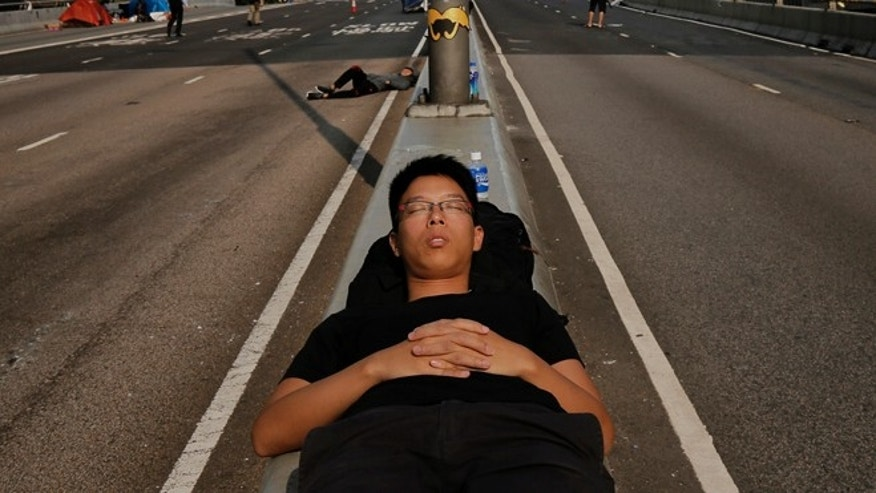 Oct. 8: A pro-democracy supporter sleeps on the streets in the occupied areas surrounding the government complex in Hong Kong.