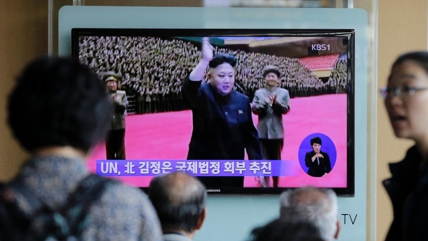 "People watch a TV news program showing North Korean leader Kim Jong Un, at the Seoul Railway Station in Seoul, South Korea, Thursday, Oct. 9, 2014. As North Korea's ruling party prepares to mark its 69th anniversary on Friday, the world will be watching to see if leader Kim will make his first public appearance in more than a month. he letters on the screen read"" UN pushes to refer North Korea leader Kim Jong Un to international court. (AP Photo/Ahn Young-joon)"