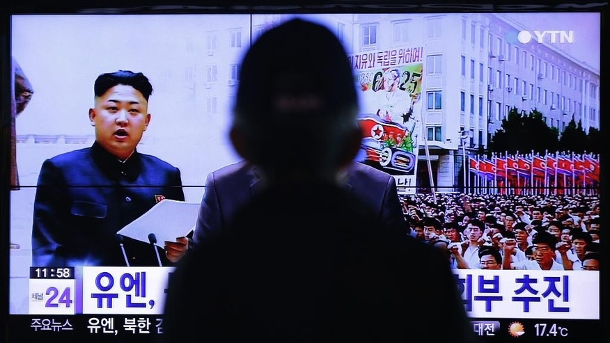 A man watches a TV news program showing North Korean leader Kim Jong Un, at the Seoul Railway Station in Seoul, South Korea, Thursday, Oct. 9, 2014. As North Korea's ruling party prepares to mark its 69th anniversary on Friday, the world will be watching to see if leader Kim will make his first public appearance in more than a month. (AP Photo/Ahn Young-joon).