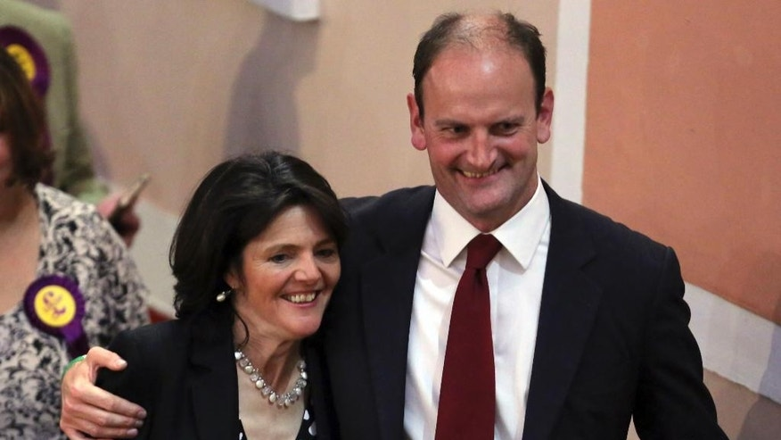 U.K. Independence Party candidate Douglas Carswell celebrates with his wife Clementine after winning a special election in the eastern England constituency of Clacton-on-Sea at a town hall in Essex, England Friday Oct. 10, 2014. The U.K. Independence Party has won a seat in the British Parliament for the first time, a significant breakthrough for the Euroskeptic, anti-immigration force. (AP Photo/PA, Chris Radburn) UNITED KINGDOM OUT, NO SALES, NO ARCHIVE