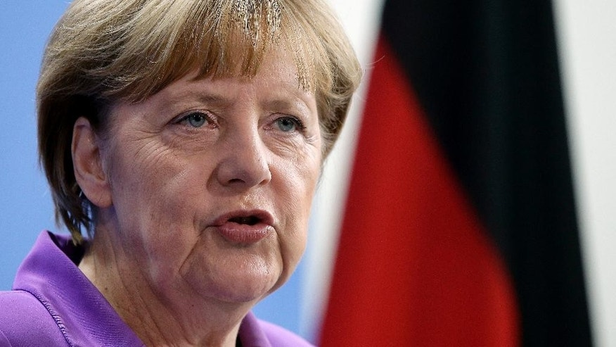 German Chancellor Angela Merkel addresses the media during a joint press conference as part of a meeting with the Prime Minister of Poland, Ewa Kopacz, at the chancellery in Berlin, Germany, Thursday, Oct. 9, 2014. (AP Photo/Michael Sohn)