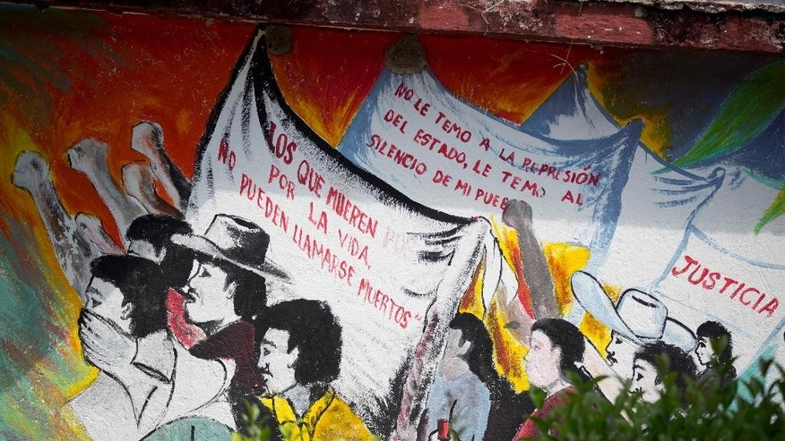 "In this Oct. 6, 2014 photo, a mural with messages that read in Spanish; ""Those who die for life, cannot be called dead,"" from left, ""I do not fear state repression, I fear the silence of the people,"" and ""Justice,"" inside the Raul Isidro Burgos rural teacher's college, also known as Ayotzinapa, in Tixtla, Mexico. Prosecutors attribute the Sept. 26 disappearances of 43 students from the rural college, to police. The case has outraged Mexicans even in a country where abuse of authority is common in remote areas. Some of the detained led authorities last weekend to mass graves holding 28 bodies that some fear are the students. Their identities are still unknown.  (AP Photo/Eduardo Verdugo)"
