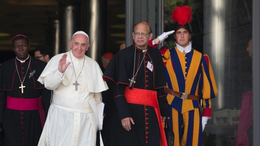 Pope Francis is flanked by Indian Cardinal Oswald Gracias as they leave at the end of the morning session of the Synod on family, a two-week meeting of 200 cardinals and bishops from around the world, at the Vatican, Thursday, Oct. 9, 2014. (AP Photo/Alessandra Tarantino)