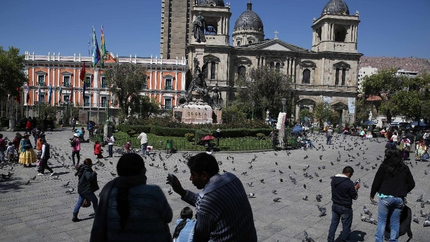 People gather in Plaza Murillo where the cathedral and government offices are located in La Paz, Bolivia, Friday, Oct. 10, 2014. Bolivia will hold general elections on Sunday. (AP Photo/Martin Mejia)