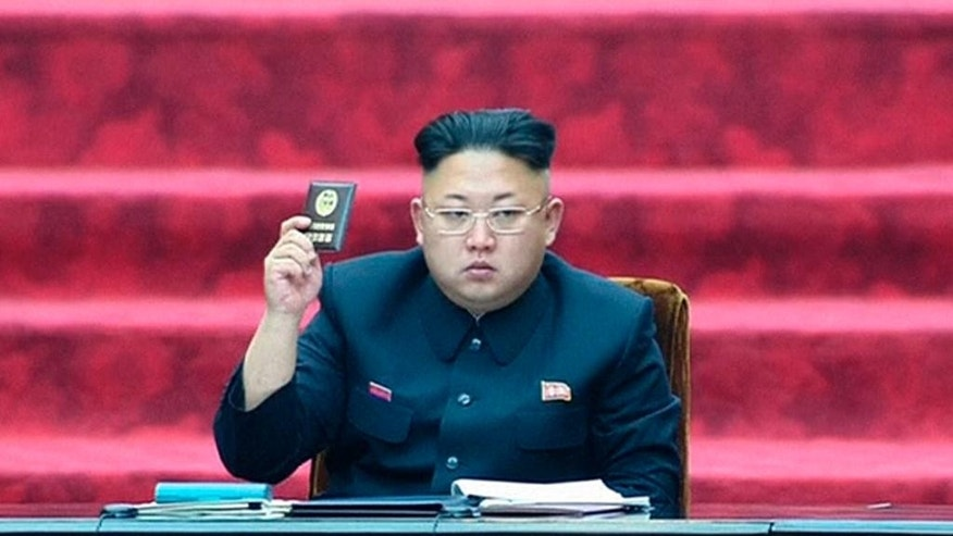 FILE - In this April 9, 2014 file image made from video, North Korean leader Kim Jong Un holds up parliament membership certificate during the Supreme People's Assembly in Pyongyang, North Korea, when it was held for the first time under the new leader. North and South Korea traded machine-gun and rifle fire Friday, Oct. 10 after South Korean activists released anti-Pyongyang propaganda balloons across the border, officials said. The exchange of fire comes as speculation grows about the condition of the North Korea's authoritarian leader who has been out of public view for more than a month. He missed a major anniversary event on Friday for the first time in three years. (AP Photo/KRT via AP Video, File) TV OUT, NORTH KOREA OUT