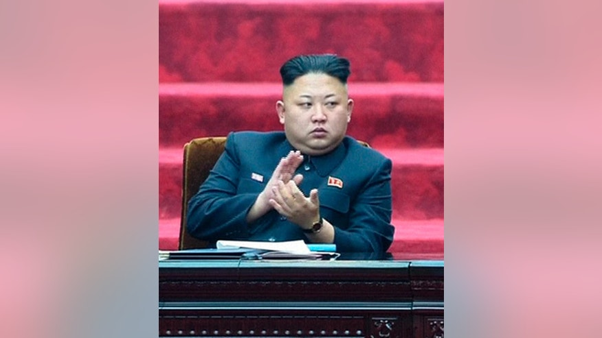 FILE - In this April 9, 2014 file image made from video, North Korean leader Kim Jong Un applauds during the Supreme People's Assembly in Pyongyang, North Korea, when it was held for the first time under the new leader. North and South Korea traded machine-gun and rifle fire Friday, Oct. 10 after South Korean activists released anti-Pyongyang propaganda balloons across the border, officials said. The exchange of fire comes as speculation grows about the condition of the North Korea's authoritarian leader who has been out of public view for more than a month. He missed a major anniversary event on Friday for the first time in three years. (AP Photo/KRT via AP Video, File) TV OUT, NORTH KOREA OUT