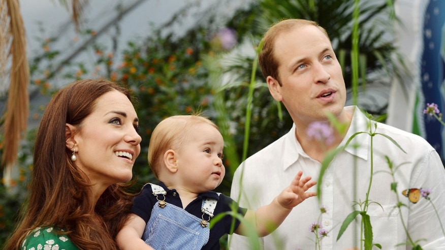 July 2, 2014 - FILE photo of Britain's Catherine, Duchess of Cambridge, carrying her son, Prince George, alongside her husband Prince William as they visit the the Natural History Museum in London.