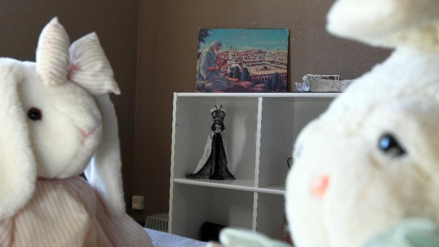 This Thursday, Oct. 2, 2014 photo shows a painting of Mecca in Sahra Ali Mehenni's bedroom at her home in Lezignan Corbieres, France. Sahra is one of the more than 100 girls from France alone who have left to join jihad in Syria, up from just a handful 18 months ago, when the trip was not even on Europe's security radar, officials say. (AP Photo/ Fred Scheiber)