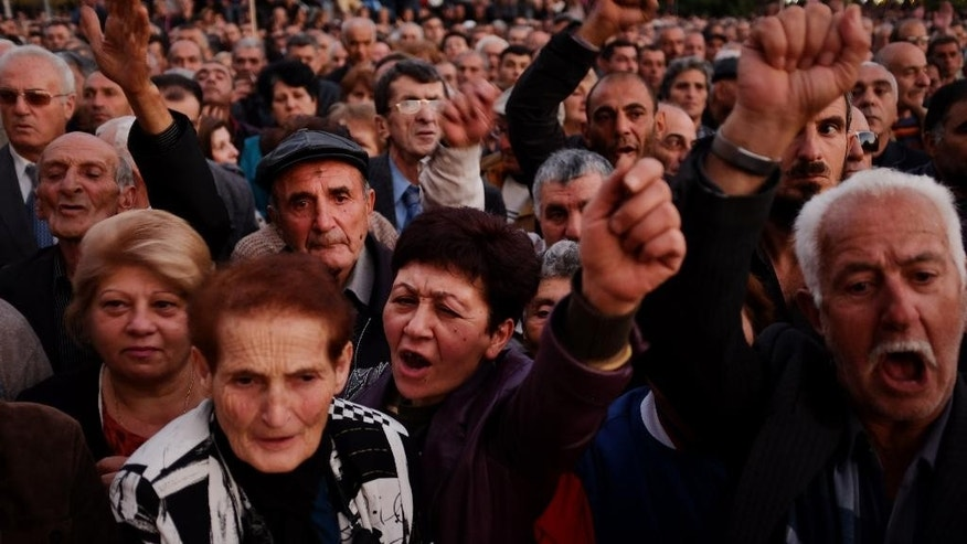 Protesters shout during an opposition rally in Yerevan, Armenia, Friday, Oct. 10, 2014. About 12,000 people rallied in the capital of Armenia to protest an impending constitutional reforms that they fear could be abused by the incumbent president. (AP Photo/Vahan Stepanyan, PAN Photo)