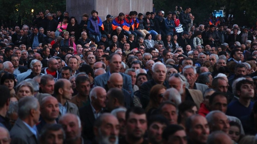 Protesters gather for an opposition rally in Yerevan, Armenia, Friday, Oct. 10, 2014. About 12,000 people rallied in the capital of Armenia to protest an impending constitutional reform that they fear could be abused by the incumbent president. (AP Photo/Hrant Khachatryan, PAN Photo)
